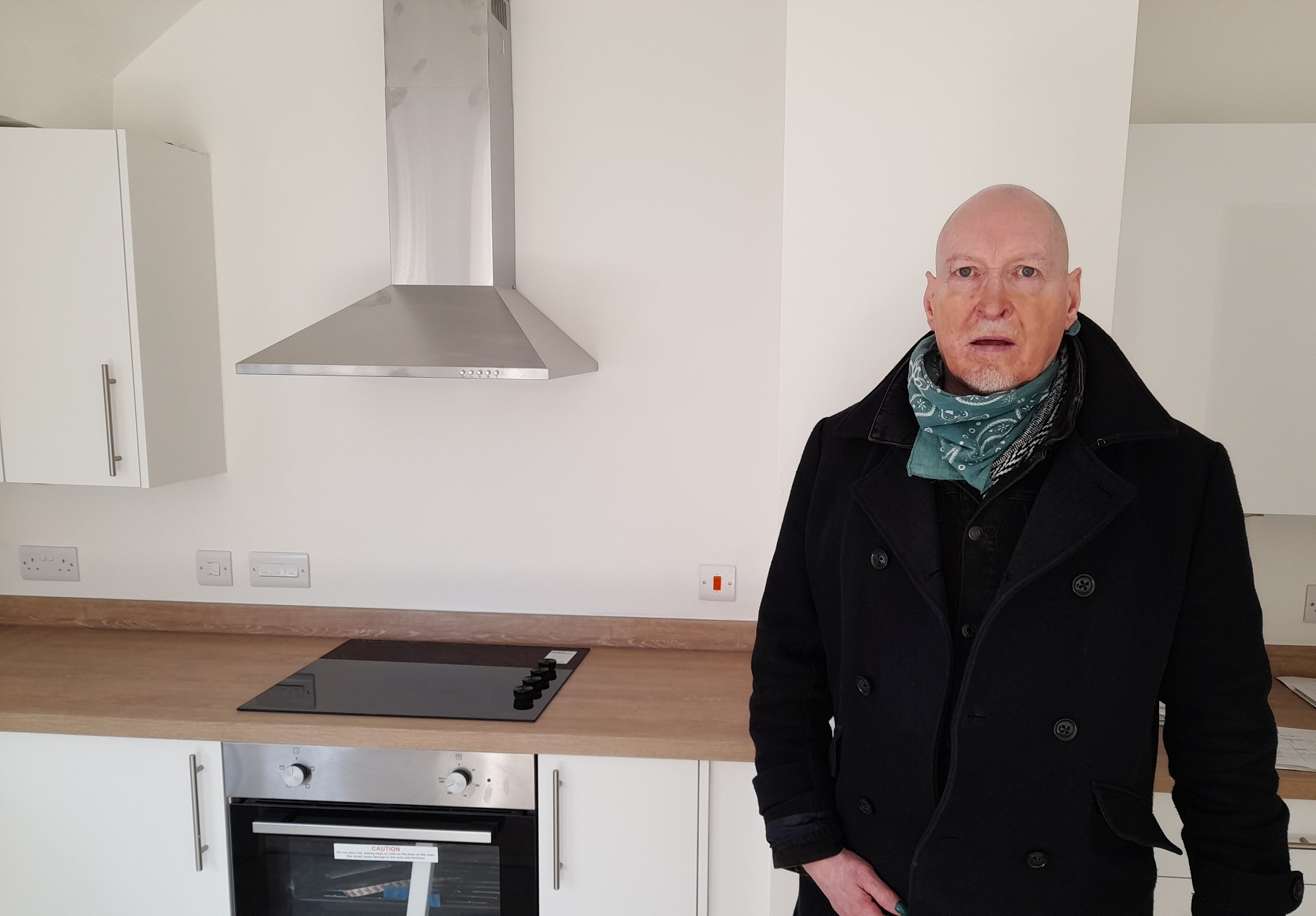 Armed Forces veteran, Neil Murphey, standing in his kitchen in his Johnnie Johnson Housing home.